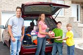 stock photo of road trip  - Smiling happy family and a family car - JPG