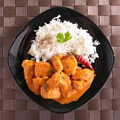 stock photo of curry chicken  - chicken cooked with curry and rice - JPG