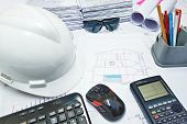 stock photo of engineering construction  - Basic instruments on working desk of a construction engineer - JPG