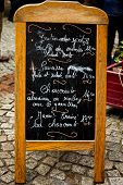 picture of alsatian  - French menu board on cobble stone sidewalk - JPG