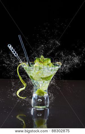 Mojito cocktail with fresh lime at the club splashing