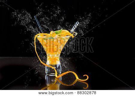Fresh orange Mojito cocktail  splashing