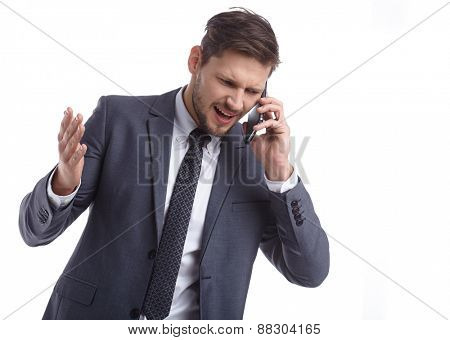 Emotional young man is talking on the phone. The human face, expression, emotion
