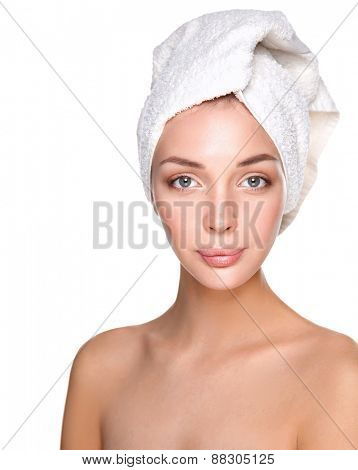 beautiful woman with a towel on her head on a white background