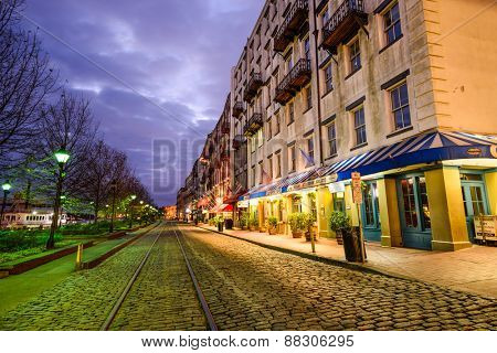 SAVANNAH, GEORGIA - JANUARY 10, 2015: Shops and restaurants line River Street. The historic street is the center of nightlife in the city.
