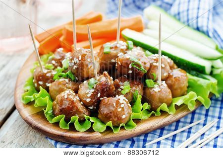 Meatballs With Teriyaki Sauce And Sesame Seeds