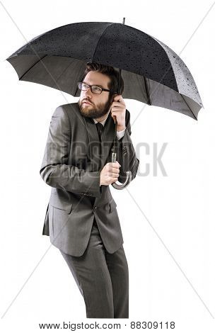 Businessman with an umbrella, isolated on white