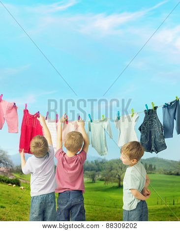 Little boys hanging laundry