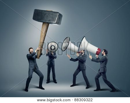 Many businessmen with megaphones