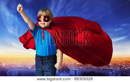 Superhero kid against urban landscape background