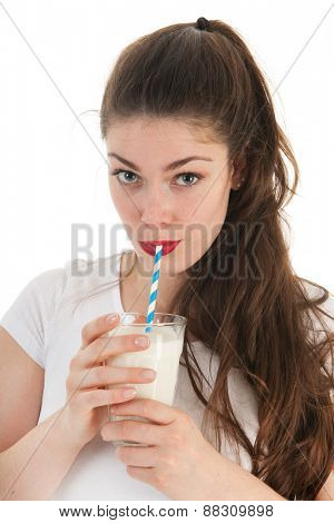 Attractive young woman drinking glass of milk