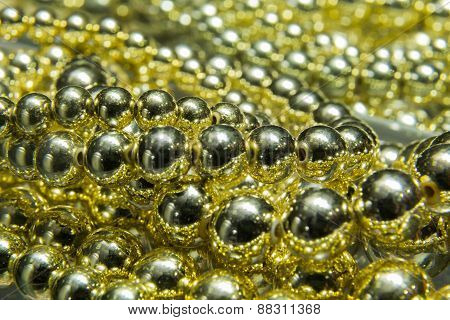 Pearls on the table, golden pearls . Texture pearls.