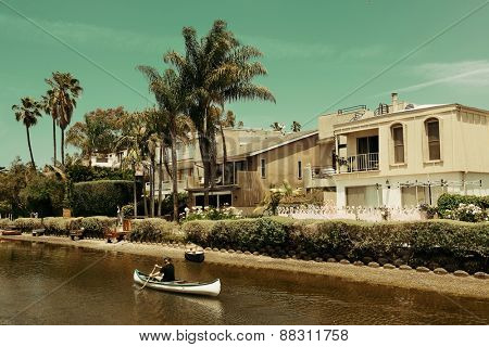 Los Angeles, CA - MAY 18: Venice Canals Walkway with boat on mountain on May 18, 2014 in Los Angeles. Los Angeles is the second-most populous city after New York in USA.
