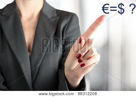Businesswoman Touching  Euro And Usd On A Virtual Graph  By Finger