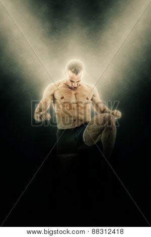 Full Length Portrait Of Boxer Fighter In Kick Motion