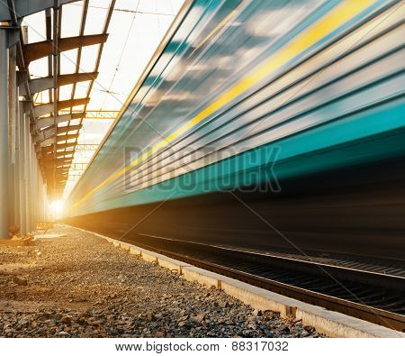 High Speed Passenger Train On Tracks With Motion Blur Effect