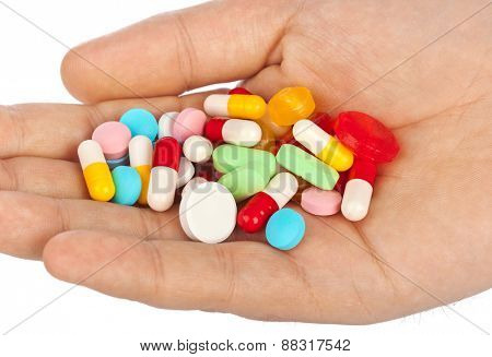 Hand with pills isolated on white background