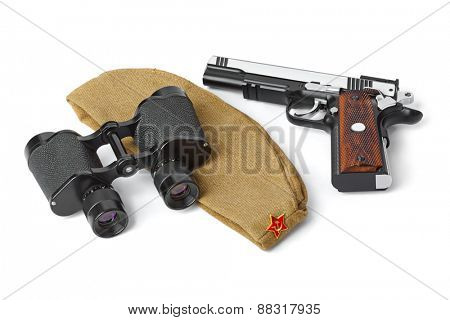 Soviet Army soldiers forage-cap, binoculars and pistol isolated on white background