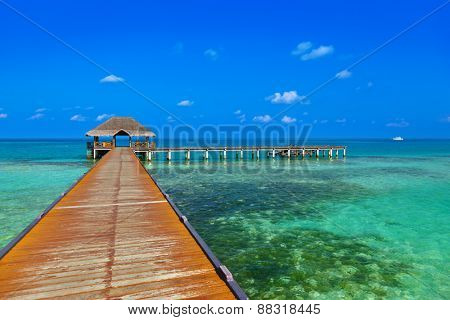 Jetty on tropical Maldives island - nature travel background