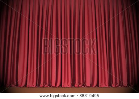 Red closed the curtain, lit by a spotlight