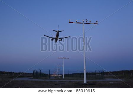 Frankfurt Airport (germany) - Plane Over Beaconing Masts At Sunset