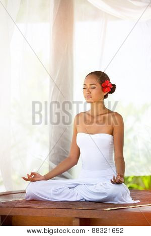 Beautiful  Asian woman doing yoga outside under baldachin