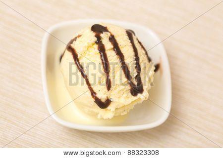 Scoop of vanilla ice cream with homemade chocolate sauce