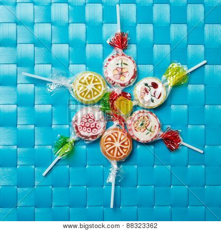 Many colorful lollipops in a circle from above