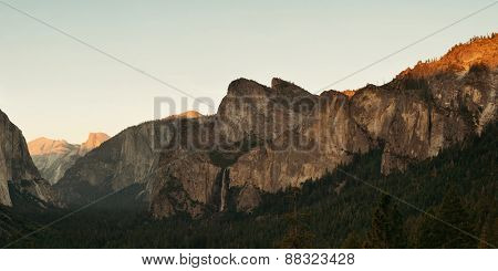 Yosemite Valley at sunset with mountains and waterfalls panorama