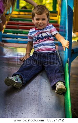 Little Boy Playing On The Playground