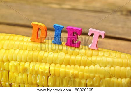 Wooden Sign Diet On Fresh Sweet Corn Close-up