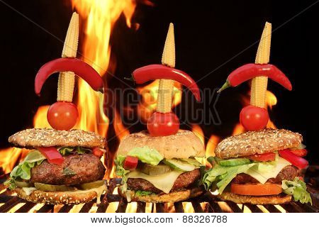 Thre Homemade Cheeseburger Close-up On Flaming Barbecue Grill Background