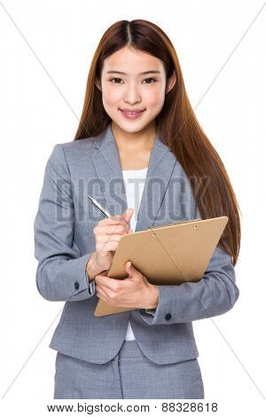Young happy smiling business woman with folder,