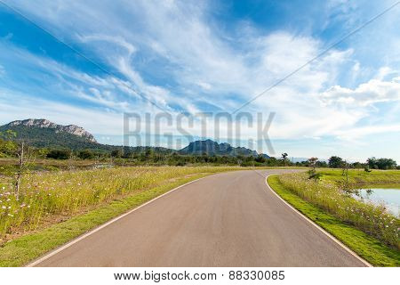 Empty Curved Road With Blue Sky