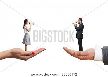 man and woman standing on the big palms and screaming at each other. isolated on white background