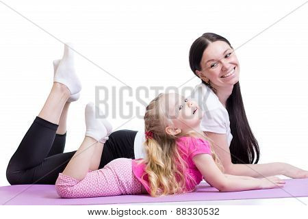 woman and child girl exercising together