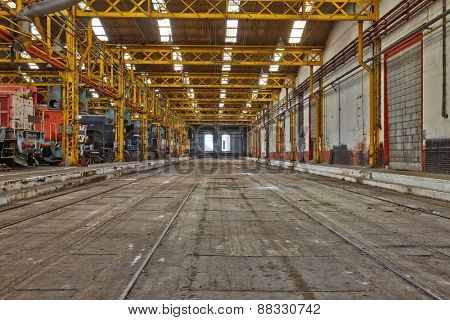 Old industrial interior hall with metal structures