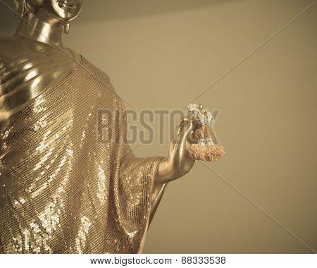 Golden Buddha Statue Hold Marigold Garland