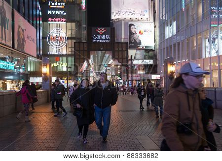 Urban Scene At Night With Many People In Osaka , Japan