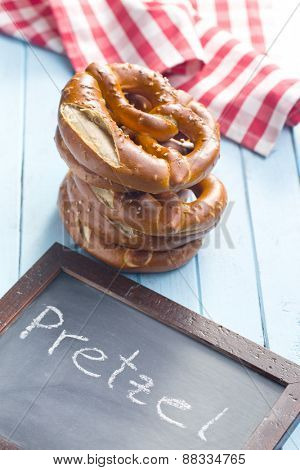 baked pretzels and chalkboard on kitchen table