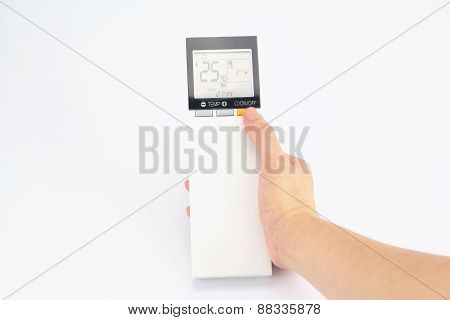 Hand Is Holding A Remote Control Of Air Conditioner
