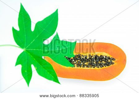 Haft Cut Papaya Fruit And Papaya Leaf Isolated Over White Background,focus On Papaya Fruit.