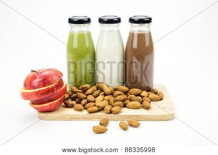 Almond Milk In Glass Bottles  With Almonds And Apple.