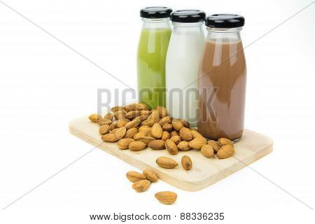 Almond Milk In Glass Bottles  With Almonds