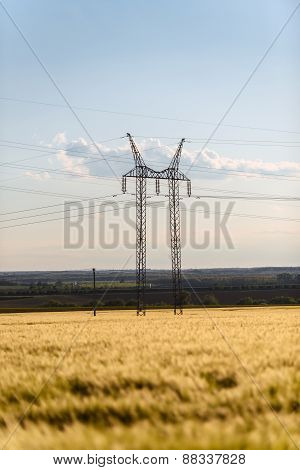 Large transmission tower with field