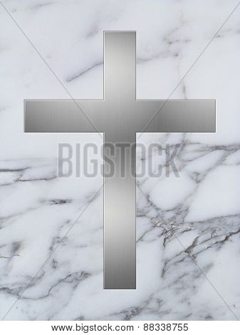 silver cross and white marble