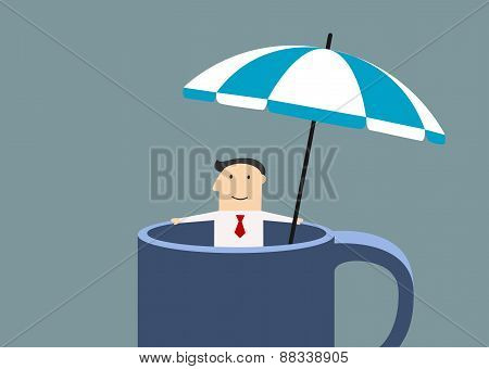 Businessman relaxing in a mug during break time