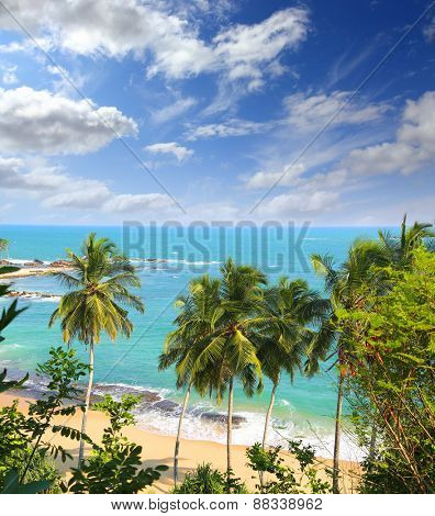 beautiful tropical beach landscape with turquoise sea and clouds