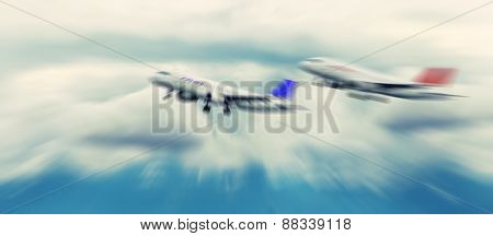 Abstract Background. Two Passenger Jets Flying Above The Clouds. Radial Zoom Blur Effect Defocusing