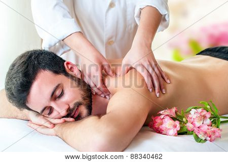 Therapist Doing Back Massage On Young Man.